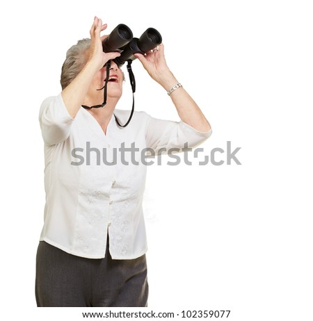 portrait of a senior woman looking through binoculars over a white background - stock photo