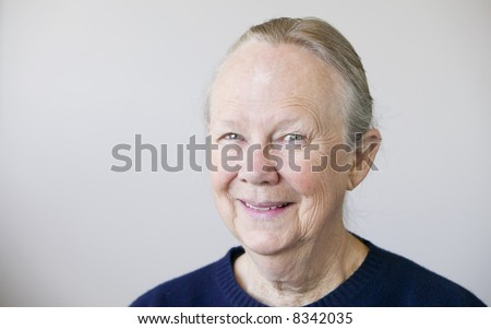 Portrait of a senior woman looking towards the camera. - stock photo