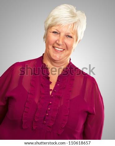 portrait of a senior woman on gray background - stock photo