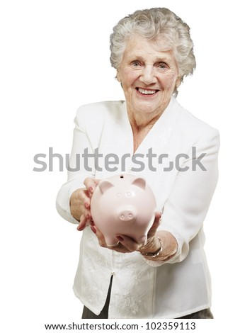 portrait of a senior woman showing a piggy bank over a white background - stock photo
