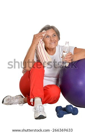 Portrait Of A Senior woman sitting on a floor with water after exercising isolated on white - stock photo