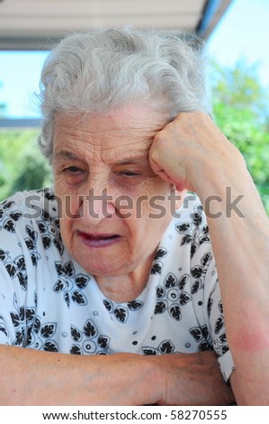 Portrait of a senior woman thinking and talking - stock photo