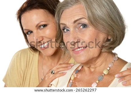 Portrait of a senior woman with daughter - stock photo