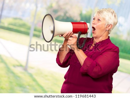Portrait Of A Senior Woman With Megaphone, Outdoor - stock photo
