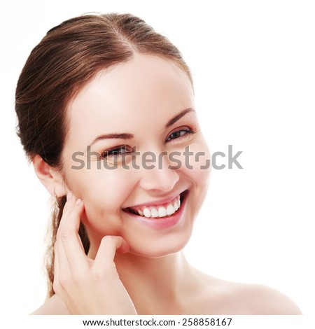 Portrait of a sensual beautiful young woman smiling isolated on white background - stock photo