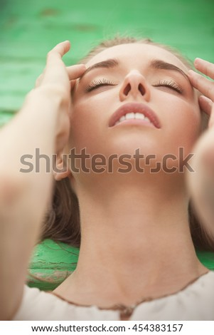 Portrait of a sensual woman with eyes closed - stock photo