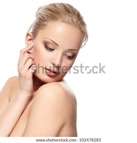 Portrait of a sensual young blond woman isolated on white background - stock photo