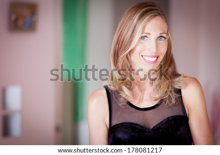 Portrait Of A Serene Classic Woman Smiling At The Camera - stock photo