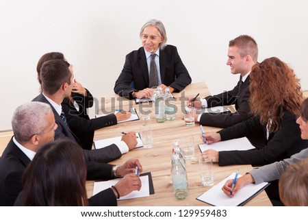 Portrait Of A Serious Business Men And Women Attending A Seminar - stock photo