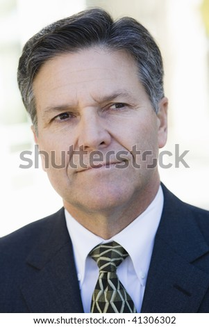 Portrait of a Serious Businessman Looking Away From Camera - stock photo