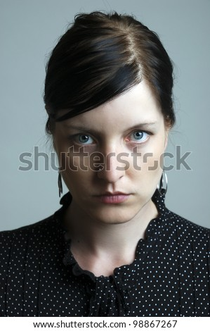 portrait of a serious looking woman - stock photo