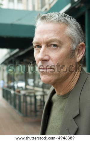 portrait of a serious man outside - stock photo