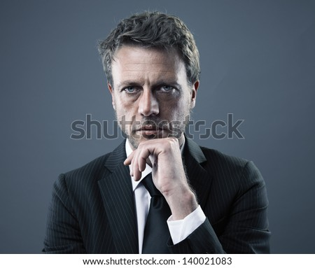 Portrait of a serious mature business man - stock photo