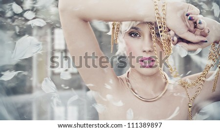 Portrait of a sexy blonde beauty - stock photo