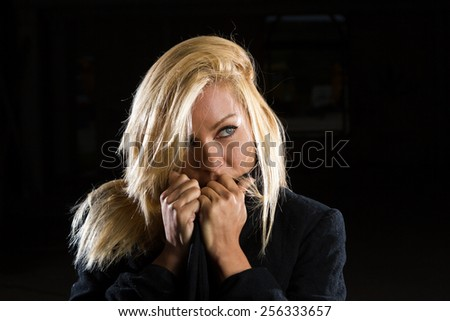 Portrait of a sexy blonde woman over black background - stock photo