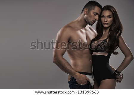 Portrait of a sexy couple in lingerie - stock photo