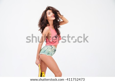Portrait of a sexy cute woman with skateboard posing isolated on a white background - stock photo