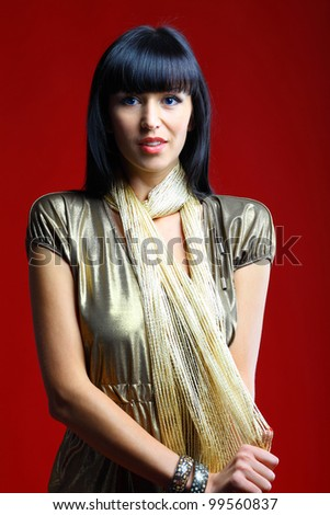 Portrait of a sexy female model posing against red background - stock photo