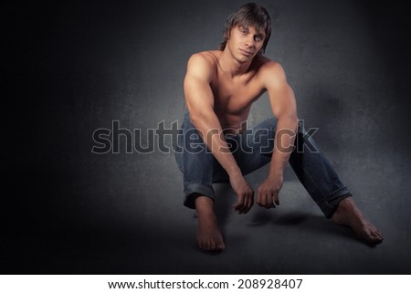 portrait of a sexy muscular shirtless man against neutral - stock photo