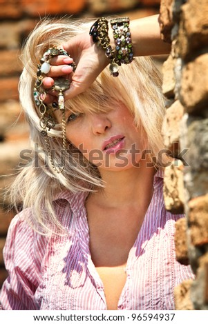 Portrait of a sexy woman  in abandoned ruins at sunny summer day - stock photo