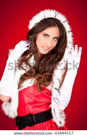 portrait of a sexy woman in santa clothes - stock photo