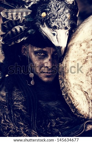 Portrait of a shaman with a drum outdoor.  - stock photo