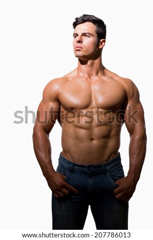 Portrait of a shirtless muscular man standing over white background - stock photo