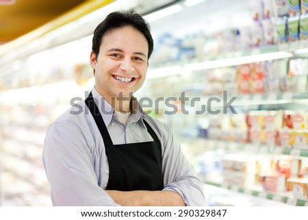 Portrait of a shopkeeper in his store - stock photo