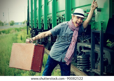 Portrait of a shouting young man holding a train. - stock photo