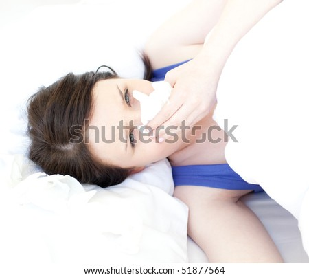 Portrait of a sick attractive woman relaxing in her bed - stock photo