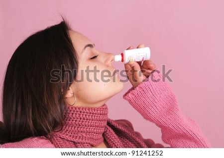 portrait of a sick girl lying at bed - stock photo
