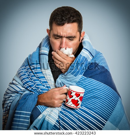 Portrait of a sick man with the flu, allergy, germs,cold coughing - stock photo