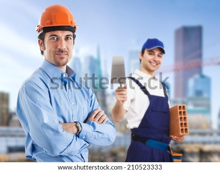 Portrait of a site manager and a bricklayer - stock photo