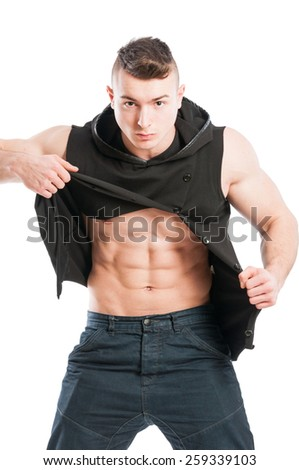 Portrait of a six pack model ripping his black hoodie to show perfect abs - stock photo