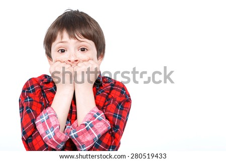 Portrait of a small boy looking very scared holding his hands near his mouth wearing checkered shirt isolated on white background - stock photo