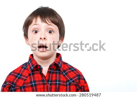 Portrait of a small boy looking very surprised holding his mouth opened wearing checkered shirt isolated on white background - stock photo