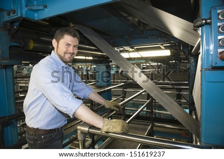 Portrait of a smart man working in newspaper factory - stock photo