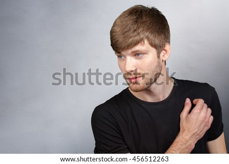 Portrait of a smart serious young man - stock photo