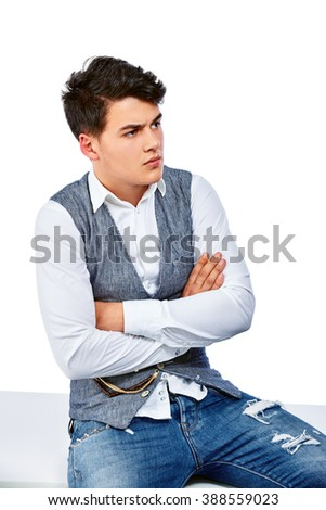 Portrait of a smart serious young man sitting against white background. Isolated. - stock photo