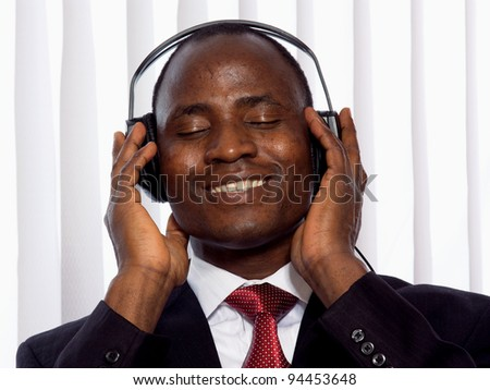 Portrait of a smiling Afro-American businessman with headset - stock photo