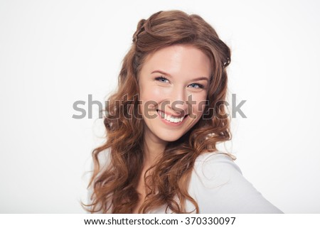 Portrait of a smiling attractive woman looking at camera isolated on a white background - stock photo