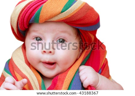 portrait of a smiling baby in a striped fabric - stock photo