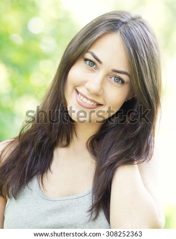 portrait of a smiling beautiful woman - stock photo