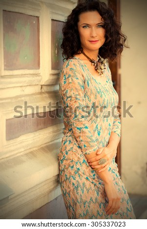 portrait of a smiling beautiful woman on open air. instagram image filter retro style - stock photo
