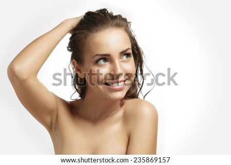 Portrait of a smiling beautiful young girl with wet hair after a shower - stock photo