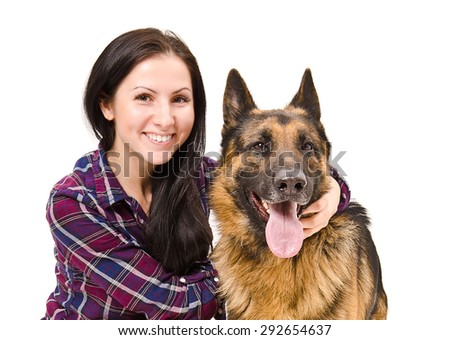 Portrait of a smiling beautiful young woman and German Shepherd closeup isolated on white background - stock photo