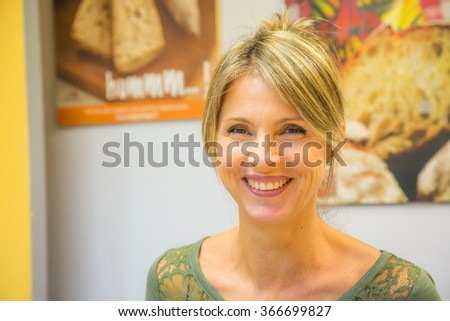 portrait of a smiling blond woman - stock photo