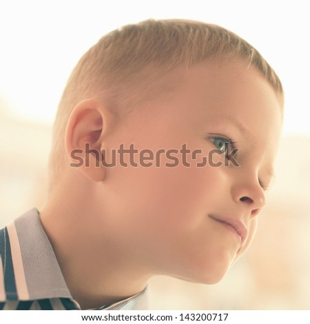 portrait of a smiling boy close-up, artistic image of a child - stock photo