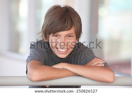 portrait of a smiling boy outdoors - stock photo