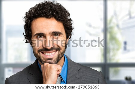 Portrait of a smiling business man - stock photo